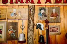 Photographs, folk artwork, and other items collected over the years hang proudly on the rustic walls at Jimmy Driftwood Barn. | Photograph by William Widmer