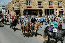 Trotting through town, participants save energy for the dancing in the Courthouse Square that erupts later in the festival. | Photograph by William Widmer